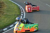 2 sidecars racing in the Isle of Man TT Races.