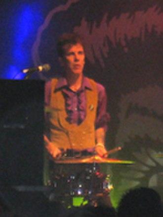 Slim Jim Phantom - SJP drumming on a two-piece kit while standing