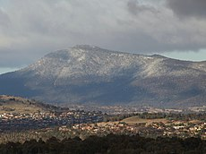 Light snow on Mount Tennent, which features dry sclerophyll woodlands.