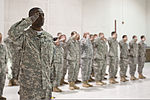 Soldiers with the Detachment 1, Company B, 2nd Battalion, 238th Aviation Regiment, General Support Aviation Battalion, render honors during the unit's farewell ceremony at McEntire Joint National Guard Base 130126-F-XH297-485.jpg