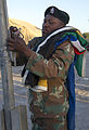 South African Army Pvt. C.R.J. Alexander secures a rope after lowering the South African flag during a rehearsal for exercise Shared Accord 2013 in Port Elizabeth, South Africa, July 21, 2013 130721-A-FP002-014.jpg