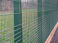 Sports Rebound Fencing with timber kickboards (6197883948).jpg
