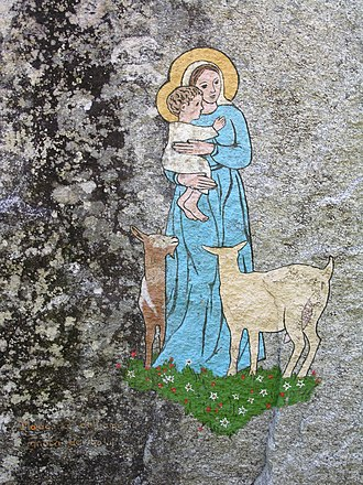 Parietal art - A painting of the Virgin Mary in the Calnegia valley in the Swiss Alps. Unlike most parietal art, this painting is modern.