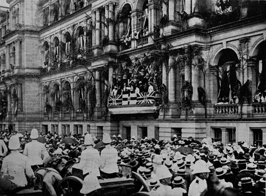 Governor of Queensland Lord Lamington reading the Queen's proclamation on Federation in Brisbane StateLibQld 2 202947 Crowds of people outside the Treasury Building, Queen Street, Brisbane, Queensland, 1901.jpg