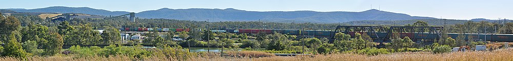 Panorama of Sugarloaf Range and freight train.