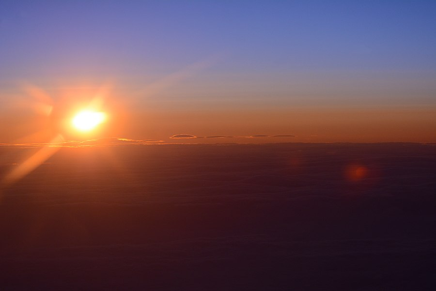Sunsets for a moment over the North Pole; at the International Date line, taken well north of the artic circle from 20,000 feet: Aug 6th 2015