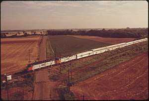 THE LONE STAR (TRAIN ^15) IS SHOWN FROM THE AIR AS IT PASSES A TYPICAL RURAL OKLAHOMA CROSSING BETWEEN GUTHRIE AND... - NARA - 556029.jpg