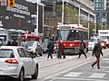 TTC streetcar visible by Dundas Square, 2015 12 01 (10) (23371362002).jpg