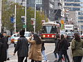 TTC streetcar visible by Dundas Square, 2015 12 01 (19) (22851255184).jpg