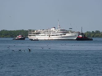 Captain John's Harbour Boat Restaurant - The MS Jadran on its last voyage, being towed out of Toronto on May 28, 2015 by tugboats.