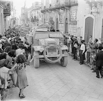 Morris C8 - British troops of the 51st Highland Division in Morris Commercial C8 FATs towing 25-pounders, are cheered by crowds as they enter Militello, 15 July 1943
