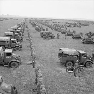 6th Armoured Division (United Kingdom) - 15-cwt trucks, carriers and motorcycles of a motor battalion in 6th Armoured Division, lined up for an inspection by the King near Brandon in Suffolk, 12 September 1941.