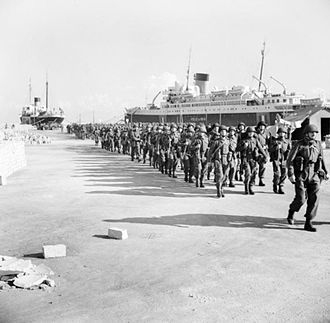 Parachute Regiment (United Kingdom) - British paratroops march away after landing at Algiers.