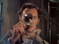 The Curse Of Frankenstein (1957) trailer - Peter Cushing with magnifying glass.png