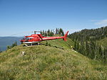 The Forest's exclusive use helicopter setting up a portable radio repeater for a fire (7204148368).jpg