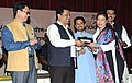 The Minister of State for Skill Development, Entrepreneurship, Youth Affairs and Sports (Independent Charge), Shri Sarbananda Sonowal felicitating the medal winners of Asian Games 2014.jpg