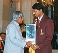 The President Dr. A.P.J. Abdul Kalam presenting the Arjuna Award for outstanding performance in the year 2003 to Olympic silver medallist Shri Rajyavardhan Singh Rathore in New Delhi on September 21, 2004.jpg