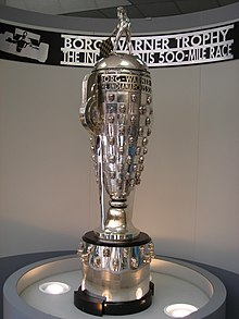 The Borg-Warner Trophy, a tall metal cup trophy topped by a figure waving a chequered flag