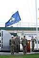 The U.S. Naval Mobile Construction Battalion (NMCB) 5 command colors are lowered during a change of charge ceremony with NMCB-3 on Camp Shields in Okinawa, Japan Aug. 18, 2013, after an eight-month deployment 130818-N-SD120-003.jpg