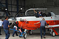 The final T-6B Texan II aircraft is maneuvered into place in the North Field hangar at Naval Air Station Whiting Field, Fla., Aug. 27, 2012 120827-N-WW980-003.jpg
