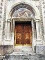 The wooden door behind the Gandzasar monastery.jpg