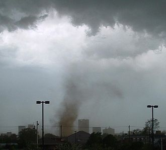Tornado - This tornado has no funnel cloud; however, the rotating dust cloud indicates that strong winds are occurring at the surface, and thus it is a true tornado.