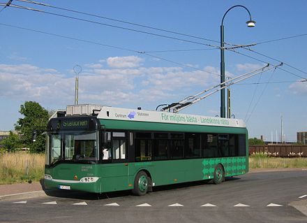 A trolleybus uses two overhead wires to provide electric current supply and return to the power source Tradbuss Landskrona.JPG