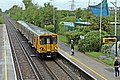Train arriving, Capenhurst Railway Station (geograph 2987033).jpg
