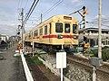 Train of Nishitetsu Kaizuka Line on north side of Kashii-Kaenmae Station.jpg