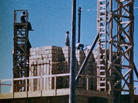 Men stack crates of high explosives for the 100-ton test Trinity Test - 100 Ton Test - High Explosive Stack 002.jpg