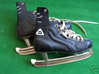 Ice skate boots with blades attached to the bottom for propelling the bearer across a sheet of ice