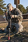 U.S. Army Staff Sgt. Cory Schmidt with 3rd Brigade Combat Team, reassembles an M240B machine gun as he competes to be the 82nd Airborne Division's Noncommissioned Officer of the Year at Fort Bragg, N.C., March 130321-A-UU237-144.jpg