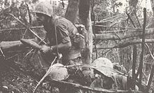 U.S. Marine with 3d Battalion, 4th Marines moves forward during Operation Prairie.jpg