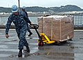 U.S. Navy Boatswain's Mate 3rd Class John Moore moves cargo across the flight deck of the amphibious dock landing ship USS Tortuga (LSD 46) May 11, 2013, at White Beach in Okinawa, Japan 130511-N-IY633-251.jpg