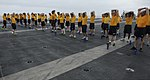 U.S. Navy chief petty officer selectees stretch after participating in a 5K run on the flight deck of the aircraft carrier USS Nimitz (CVN 68) Aug. 18, 2013, in the U.S. 5th Fleet area of responsibility 130818-N-IB033-363.jpg