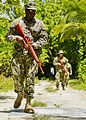 U.S. Sailors assigned to Naval Support Facility Diego Garcia conduct a mock reconnaissance patrol Nov. 9, 2013, in Diego Garcia, British Indian Ocean Territory 131109-N-S2424-156.jpg