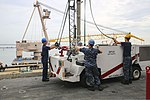 U.S. Sailors prepare to unload a P-25 fire truck from an elevator aboard the aircraft carrier USS Dwight D. Eisenhower (CVN 69) Aug. 21, 2013, at Naval Station Norfolk, Va 130821-N-RC063-009.jpg