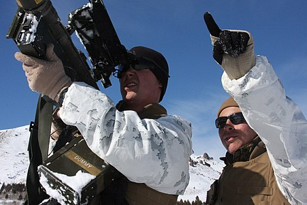 A U.S. Marine antiaircraft gunner aims his Stinger at a location indicated by a spotter. USMC-090212-M-6603L-077.jpg