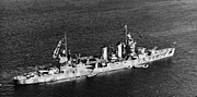 USS Tuscaloosa (CA-37) moored in Scapa Flow, in April 1942 (80-G-12018)