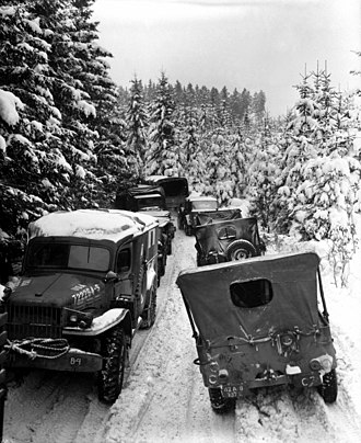 87th Infantry Division (United States) - Vehicles of the U.S. 87th Infantry Division in the woods near Wallerode/St. Vith, Belgium, on 30 January 1945.