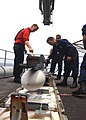 US Navy 020805-N-9593M-008 Sailors prepare to load RIM-7 missiles into one of the ship's launchers aboard CVN 72.jpg