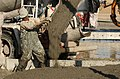 US Navy 030104-N-5319A-012 Seabees attached to Naval Mobile Construction Battalion Seventy-Four (NMCB-74) pour concrete for a C-130 aircraft staging area.jpg