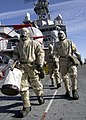 US Navy 030116-N-5027S-004 Advanced Chemical Protective Garments while on an investigation team during a chemical, biological, and radiological attack CBR drill.jpg
