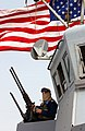 US Navy 030321-N-0000G-010 Sailor scans the horizon for contacts and potential aggressors from aboard the Cyclone Class patrol boat, USS Chinook (PC 9).jpg