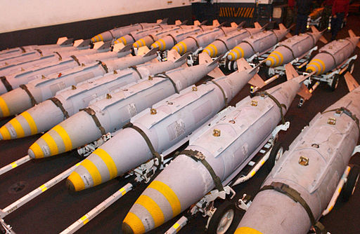 US Navy 030323-N-1328C-507 GBU-31 Joint Direct Attack Munitions (JDAM) are staged in the hanger bay