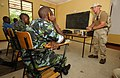 US Navy 040108-N-3236B-001 Equipment Operator 2nd Class John Flemming from Philadelphia, Pa., assigned to Explosive Ordnance Mobile Unit Three (EODMU-3) Detachment One, Stationed in San Diego Calif., provides training to Kenyan.jpg