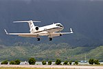 US Navy 040421-N-3228G-011 A C-20G Gulfstream aircraft makes a final approach for a touch and go landing during a local training flight.jpg