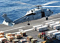 US Navy 040423-N-7408M-004 An SH-60F Seahawk hovers just above the flight deck of USS Enterprise (CVN 65).jpg