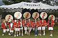 US Navy 040904-N-2150M-007 Sailors assigned to Misawa Air Base, Japan, pose in front of Japanese drums at the Kunizakai Festival.jpg