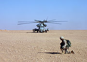US Navy 041222-N-7254H-001 A U.S. Marine, assigned to 3rd Light Armored Reconnaissance Battalion (LAR), provides security near a CH-53E Super Stallion helicopter near Ar Rutbar, Iraq